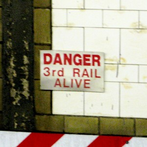 The third rail of an electrical subway system carries the current - touch it and you're dead